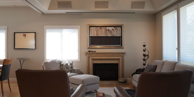 Marin Custom Home Theater-Showing a picture of the art work rolling upward revealing the hidden plasma.