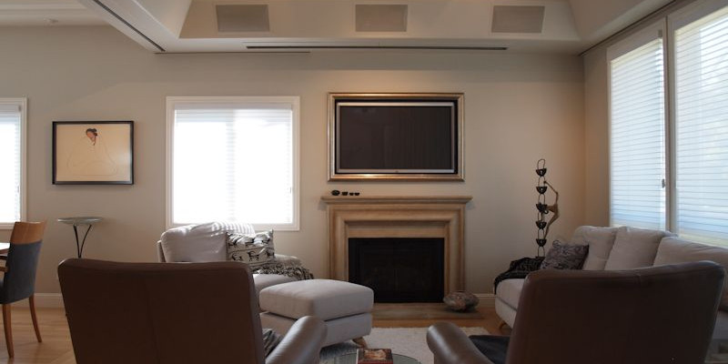 Marin Custom Home Theater-Showing a picture of the art work rolled completely upward revealing the hidden plasma.